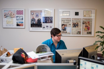 Denver Post Marijuana Editor Ricardo Baca works at his desk Jan. 12, 2016 with some of the paper's Pulitzer Prizes in the background. Patrick Traylor, The Denver Post
