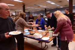 Kingston NewsGuild President Patricia Doxsey hands out slices of pie to Guild members during a union activity intended to call attention to the fact that employees of the Daily Freeman have gone for eight years without a raise. They deserve a bigger piece of the pie.