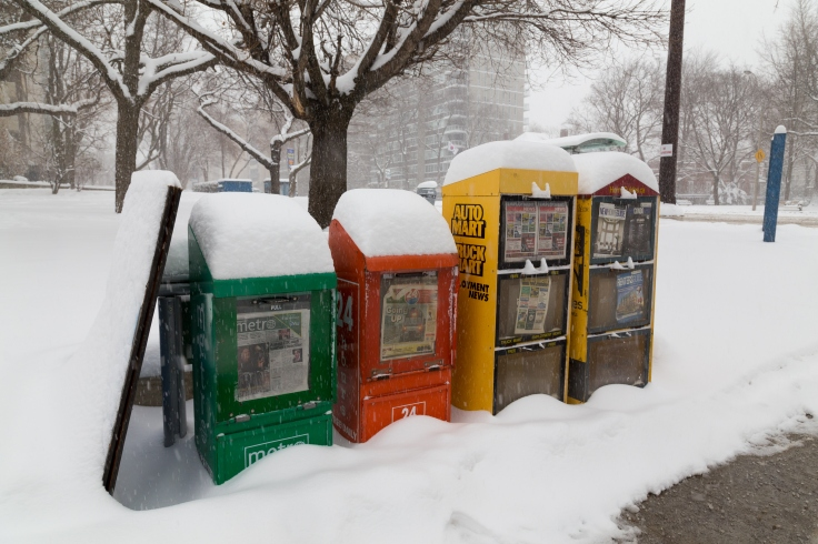 Newspaper Bins in the Snow in Toronto