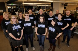 Members of the Denver Newspaper Guild wear their #NewsMatters shirts in the Denver Post newsroom. Back row from left: Barbara Ellis, Aleta Labak, John Ingold, Tom McGhee, Jon Murray, Patrick Traylor and Ian Gassman. Front row from left: Noelle Phillips, John Wenzel, Peyton Garcia, Susan Gonzalez and Danika Worthington. Photo by Helen H. Richardson